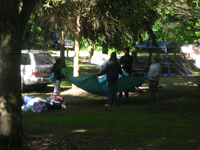 How many girls does it take to set up a tent? Uhh... 1, 2, 5, 8...